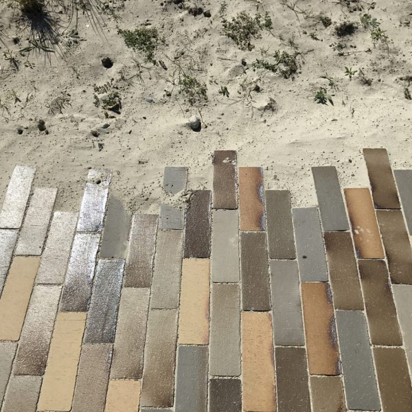 paving blending into sand